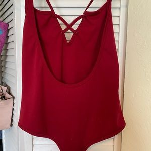 Red jumpsuit with back plunge